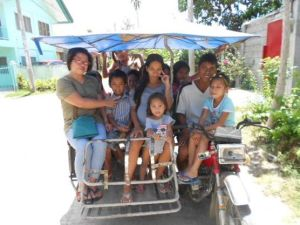 Our class hitching a ride from Edelweiss's dad, along with her mom and younger sister. She is sitting on her dad's lap. :)